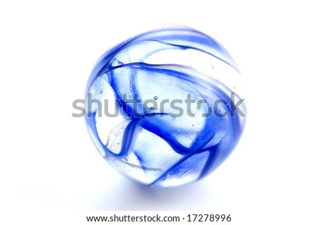 Macro shot of blue marbles on white background