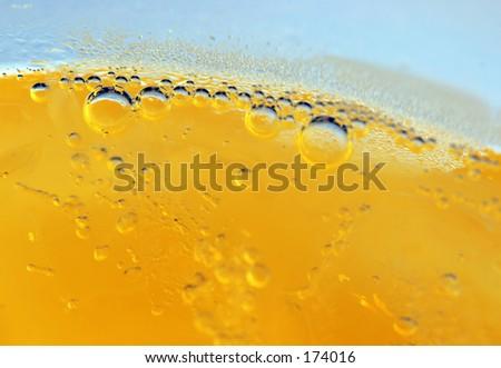Macro shot of bubbles in yellow liquid