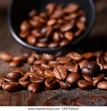 Macro shot of coffee beans on wooden background