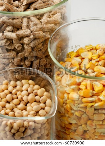 macro shot of corn, soybeans and wood pellets in glass beakers