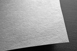 Macro shot of corner of paper. Mockup. Close up