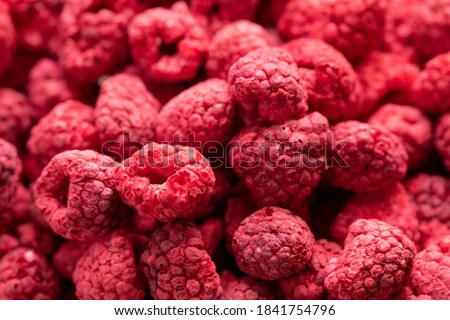 Macro shot of freeze dried organic raspberries, raw delicious snack, cooking baking ingredients. Red berries juicy summer background. Natural sugars, healthy food, fresh fruits concept, text space ストックフォト ©
