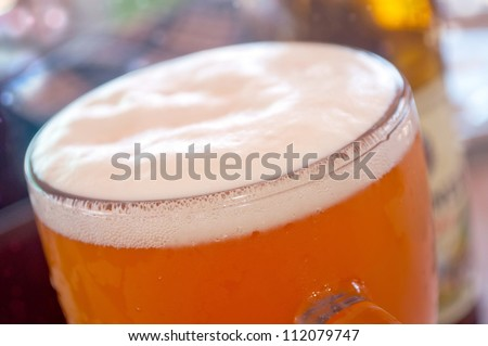 Macro shot of full glass of beer in the restaurant