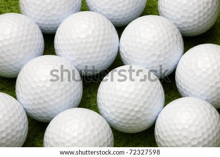 Macro shot of golf ball on putting green, can be used as background