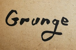 macro shot of grunge word written with black ink, on very old paper