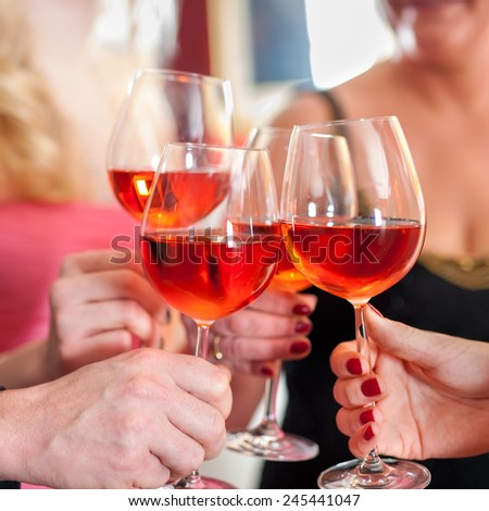 Macro Shot of Hands Raising Glasses of Tasty Red Wine in a Social Gathering. #245441047