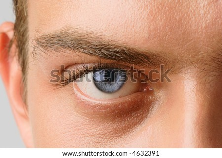 Macro shot of man's eye with visible blood vessels #4632391