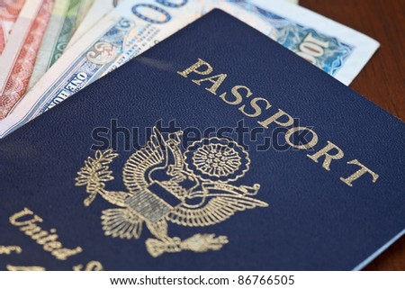 Macro shot of passport and foreign currency