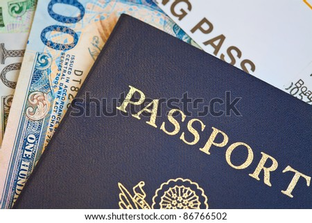 Macro shot of passport and foreign currency with boarding pass