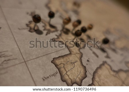 macro shot of pins over travel destinations in Europe            #1190736496