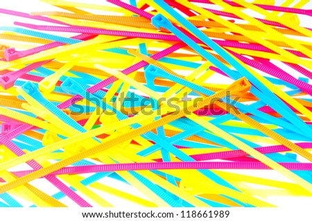 Macro shot of several colorful tie wraps isolated on white - stock photo
