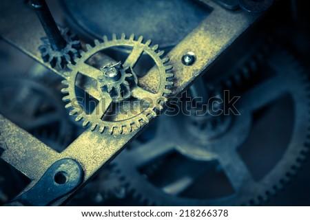 Macro shot of the clock mechanism. Color toned  image. Cross process.