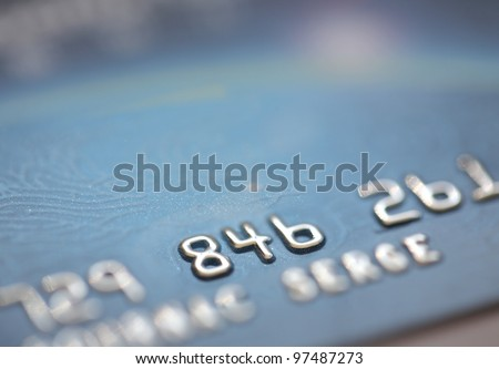 Macro shot of three digits of a whole credit card number, closeup