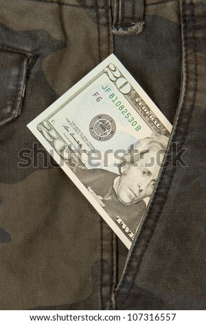 Macro shot of trendy jeans with american 20 dollar bill on its pocket