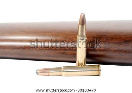 Macro shot of two bullets and a rifle stock