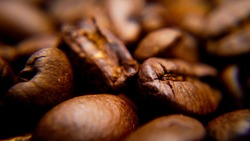 Macro shot over roasted coffee beans - food photography