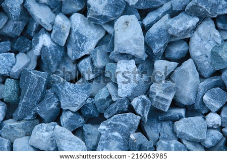 macro texture isolated crushed gray stone in natural lighting