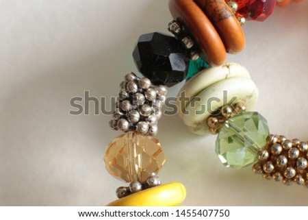 Macro view of a necklace of multicolored crystal and stones glistening and shimmering