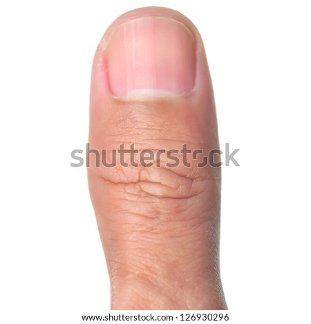 Macro view of a thumb finger over a white background.
