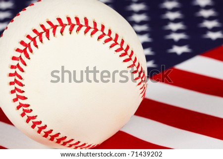 macro view of baseball set on an american flag, baseball, stars and stripes our national pastime