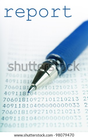 Macro view of blue pen on a report with many digits