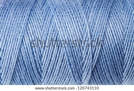 Macro view of blue thread wound on a spool