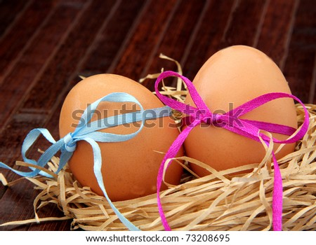 Macro view of eggs with ribbon