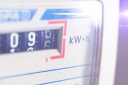 macro view of electricity watt meter, kilowatt calculator counter at home, savings economy