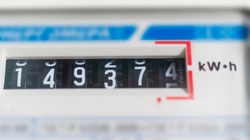 macro view of electricity watt meter, kilowatt calculator counter at home, savings economy