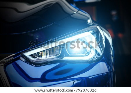 Macro view of modern blue car xenon lamp headlight #792878326