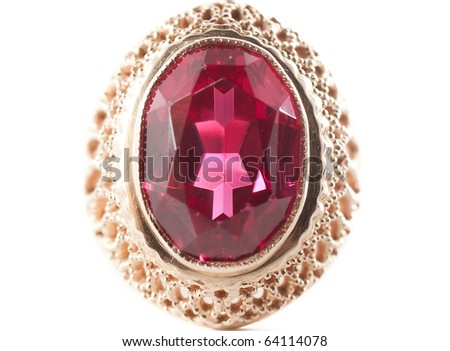 Macro view of old golden ring with red gem.