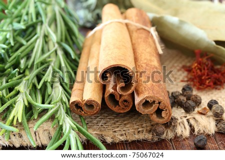 Macro view of the different spices on wooden background