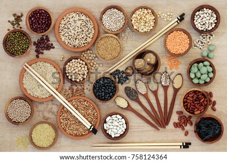 Macrobiotic diet healthy food  with cereals, grains, wakame seaweed, legumes, seeds, wasabi nuts and vegetables. High in fibre, antioxidants and minerals. Top view.