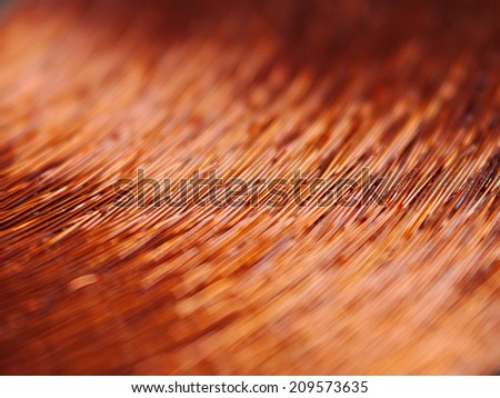 Macrodetail of a copper inductor in a transformer. #209573635