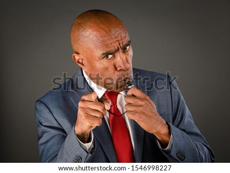 Mad male corporate or government whistleblower blowing Stock photo ©