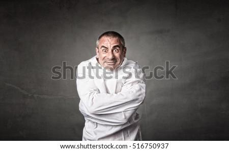 mad man with straitjacket, dark background Photo stock ©