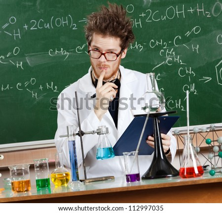 Mad professor considers the results of tests in his laboratory