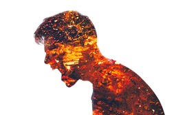 Mad scream. Angry man. Conflict person. Aggression neurosis. Double exposure of furious male silhouette coated in red hot lava isolated on white background.