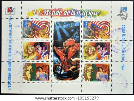 MADAGASCAR - CIRCA 1994: Collection stamps dedicated to the world of music, shows Marilyn Monroe, Elvis Presley, Bill Clinton, Louis Armstrong, John Lennon and Ella Fitzgerald, circa 1994