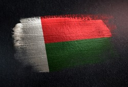 Madagascar Flag Made of Metallic Brush Paint on Grunge Dark Wall