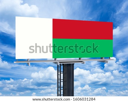 Madagascar Flag on Bricks Wall. National Flag of Madagascar on Street.