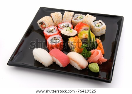 made dish of rolls and sushi