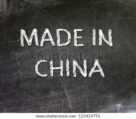 Made in China handwritten with white chalk on a blackboard.