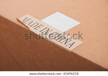 Made in China label. Cardboard package box with paper label \