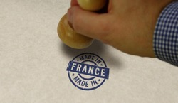 Made in France stamp and stamping hand. Factory, manufacturing and production country concept.