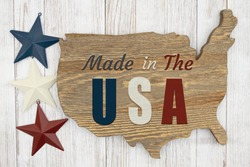 Made in the USA wood sign of US wood map with stars on weathered whitewash wood