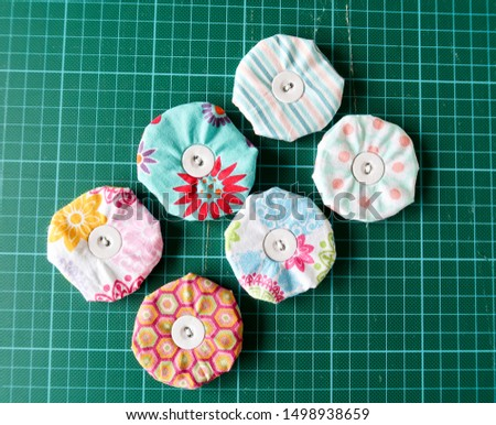 made of metal discs covered with cotton fabric weights made for the tailor's needs, Sewing supplies from metal discs