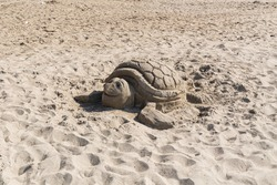 made of sand on the beach sand sculpture of a turtle