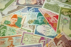 Made the Pakistani Rupee (PKR) banknotes from Pakistan as background