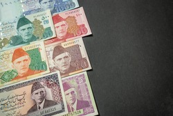 Made the Pakistani Rupee (PKR) banknotes from Pakistan as the background on the black paperboard